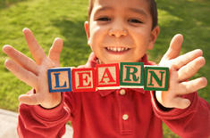child-with-learn-letter-blocks.jpg